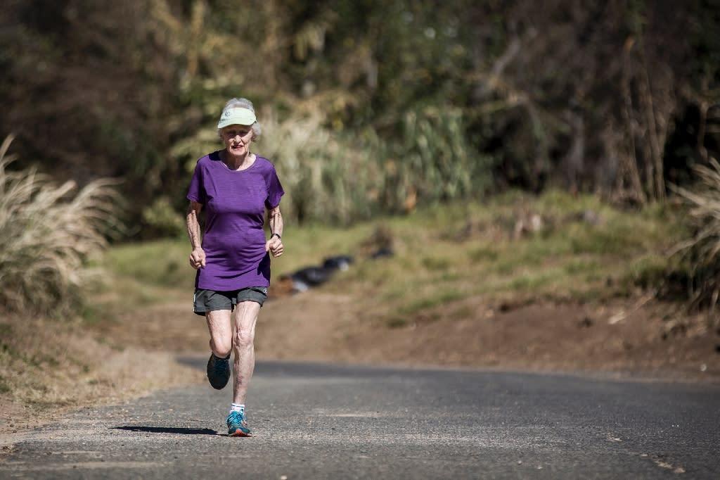 Deirdre Larkin, 85, holder of the half marathon world record for her age, each morning runs an 8-kilometre (5-mile) training course close to her home in a Johannesburg suburb (AFP Photo/GULSHAN KHAN )