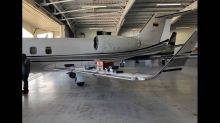 The cargo in the Learjet, along with $20,000, led to arrest of 2 Venezuelans, feds say