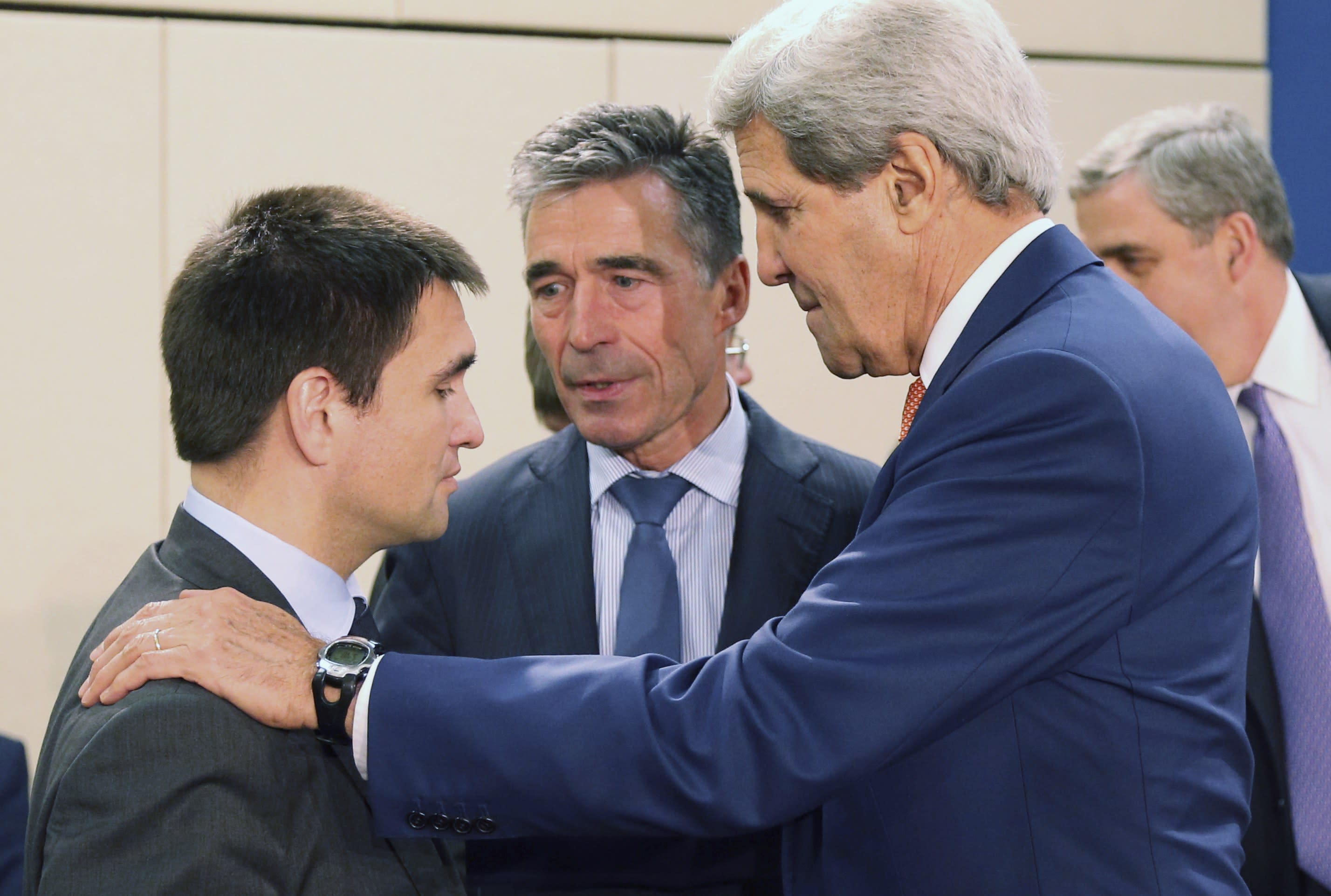 Ukraine's Foreign Minister Pavlo Klimkin (L) listens to U.S. Secretary of State John Kerry (R) and NATO Secretary General Anders Fogh Rasmussen during a NATO-Ukraine foreign ministers meeting at the Alliance headquarters in Brussels June 25, 2014. REUTERS/Francois Lenoir (BELGIUM - Tags: POLITICS MILITARY)