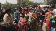 India's biggest cities shut down as new virus cases hit 200K