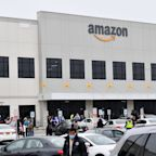 Amazon begins running temperature checks and will provide surgical masks at warehouses