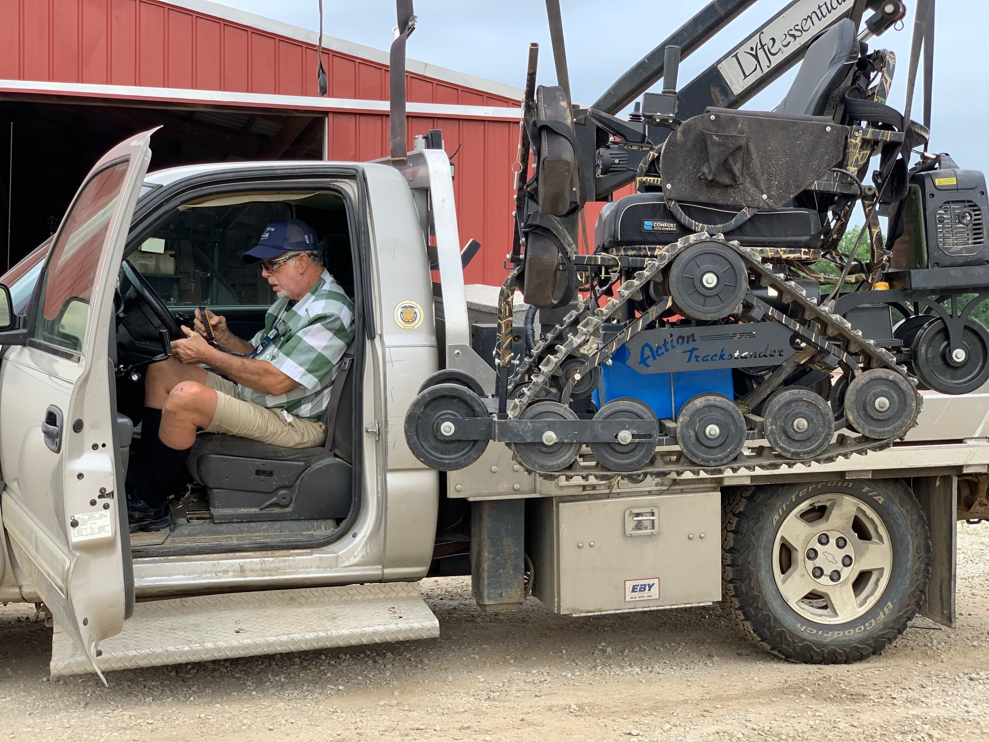 In this July 10, 2019, photo, farmer Mark Hosier, 58, works on his farm in Alexandria, Ind. Hosier was injured in 2006, when a 2000-pound bale of hay fell on him while he was working. Assistive technology, help from seasonal hires and family members, and a general improvement in the health of U.S. seniors in recent decades have helped farmers remain productive and stay on the job well into their 60s, 70s and beyond. (Andrew Soregel via AP)