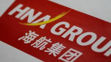 China's HNA buys back bonds, bank flags repayment issue