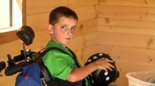 Boy with special needs gets custom log cabin in his backyard