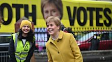 Sturgeon meets voters at polling station and supports former refugee candidate