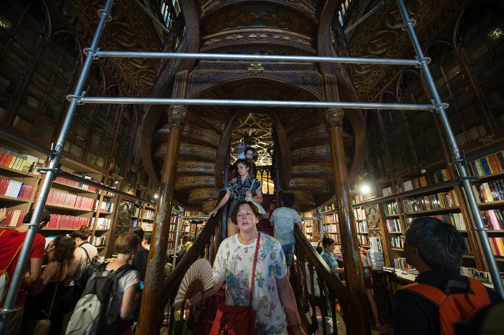 Lello's fine staircase will emerge once again after being clad in scaffolding since April (AFP Photo/Miguel Riopa)