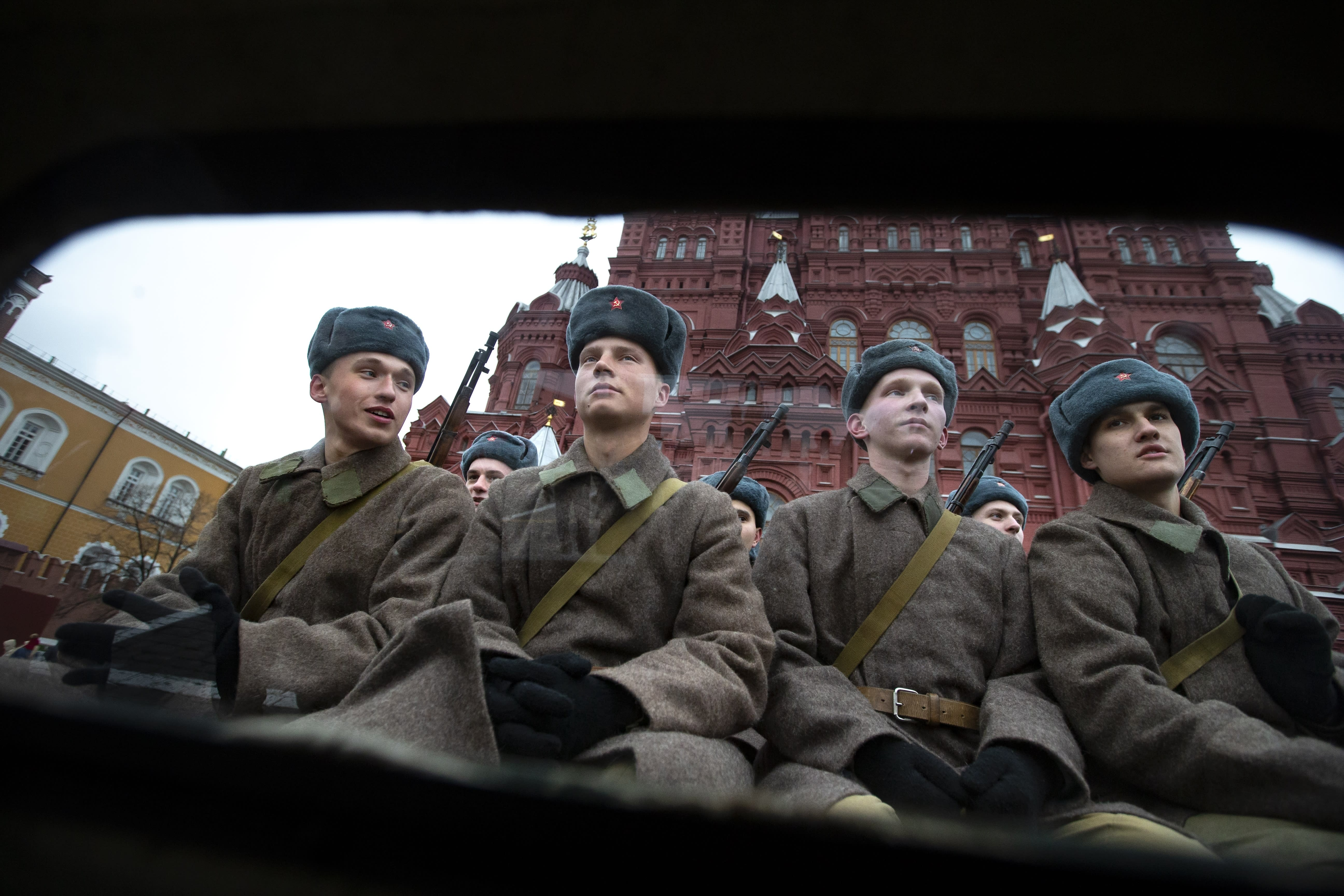 Russian soldiers dressed in Red Army World War II winter uniforms sit in a truck as they wait to take a part in a reconstruction of a World War II-era parade in Moscow's Red Square, Russia, Thursday, Nov. 7, 2019. The Nov. 7, 1941 parade saw Red Army soldiers move directly to the front line in the Battle of Moscow, becoming a symbol of Soviet valor and tenacity in the face of overwhelming odds. (AP Photo/Alexander Zemlianichenko)
