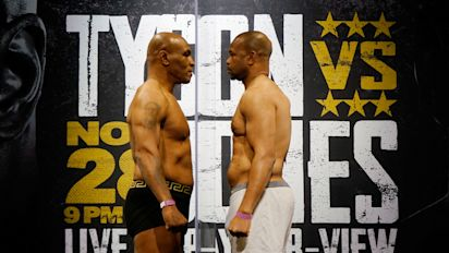 Tyson, Jones box to a draw in entertaining bout