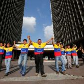 Venezuela government aims to sink Maduro recall, opposition protests