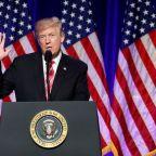 Trump signs defense policy bill, urges U.S. Congress to fund it