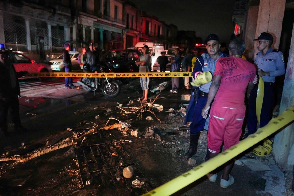 Police cordoned off a street in Havana's Luyano neighborhood, an area hard hit by the rare tornado to strike the Cuban capital (AFP Photo/ADALBERTO ROQUE)