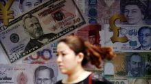 Asian currencies firm, even as Philippine peso sinks