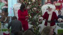 Michelle Obama dances with Santa Claus during hospital visit
