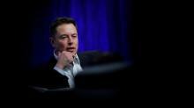 Musk to buy $20 million in Tesla stock
