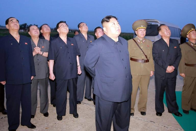This picture released by North Korea's Korean Central News Agency (KCNA) on August 7, 2019 shows North Korean leader Kim Jong-Un (front C) observing the test-fire of two new-type tactical guided missiles on August 6 -- another test came on August 10 (AFP Photo/KCNA VIA KNS)