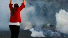 What To Do If You're Hit By Tear Gas Or Pepper Spray While Protesting