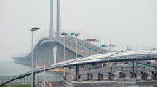 Hong Kong bridge: China opens world's longest sea-crossing bridge that stretches over 34 miles
