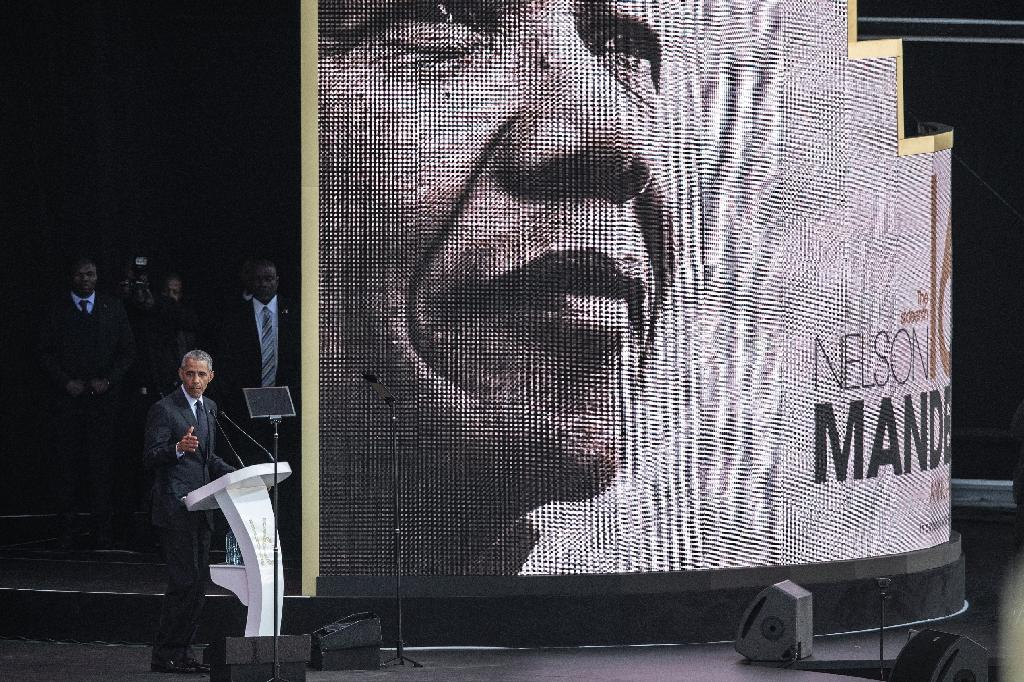 """Changing times: Obama warned of the """"politics of fear and resentment"""" in the annual Nelson Mandela lecture in Johannesburg (AFP Photo/GIANLUIGI GUERCIA)"""