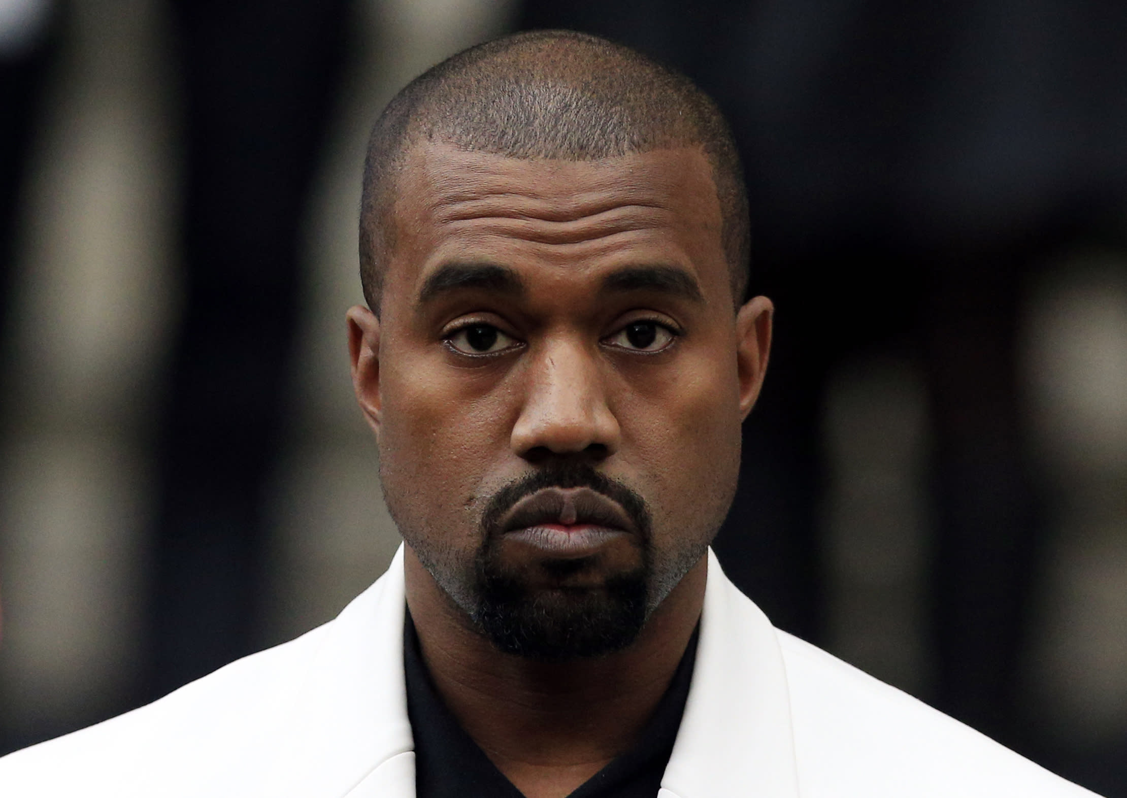 <p>Kanye West professed his adoration for Trump in a series of tweets showing off his signed MAGA hat, and said: 'I don't agree with everything anyone does. That's what makes us individuals.' (PA) </p>