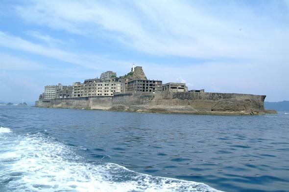 <p> 	Hashima Island or Gunjanjima as it's also known became a ghost island in 1974. It had residents from 1887 and was used for coal mining, which was in operation during the industrialisation of Japan. The country's first large concrete building was built here in 1916 as a block of apartments to accommodate the workers and protect against typhoon destruction. The 1960s saw petroleum replace coal so Japan's coal mines started to close, leading to Gunjanjima being abandoned. Today there are tour boats that depart from various locations in Nagasaki Port giving tourists a close look at the abandoned concrete buildings and its sea wall.</p>