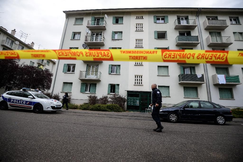 Police guard a security perimeter near a building where a fire broke out overnight killing five people, in the eastern French city of Mulhouse, on October 2, 2017
