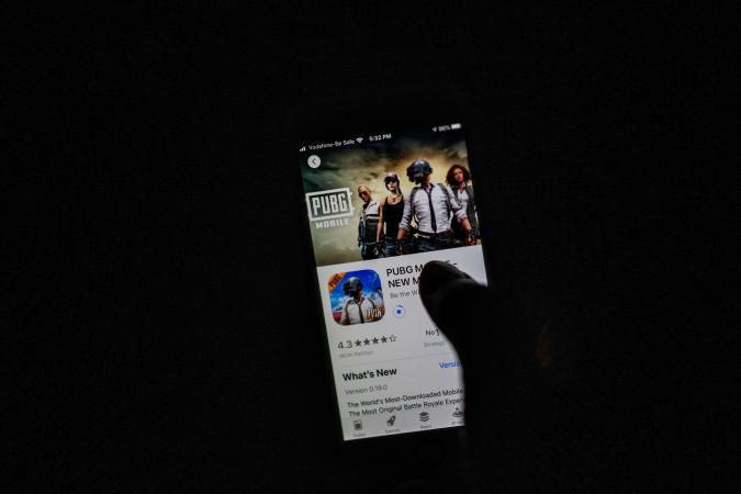 """A man looks at the """"PUBG Mobile"""" game, owned by Chinese internet giant Tencent, in the App Store on an Apple iPhone in New Delhi on September 2, 2020. - India on September 2 banned 118 Chinese apps as it stepped up economic hostilities over an increasingly bitter border showdown between the giant neighbours. (Photo by Jewel SAMAD / AFP) (Photo by JEWEL SAMAD/AFP via Getty Images)"""