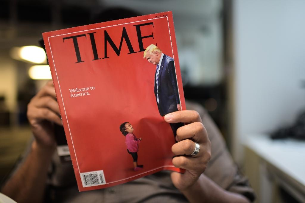 Time Magazine has come under fire for its cover on migrant families being separated by Donald Trump's administration -- since the child depicted was not affected by the practice (AFP Photo/Eric BARADAT)