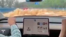 Watch this video filmed from inside a Tesla as it wades through flood waters almost up to its windshield