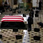 Ruth Bader Ginsburg's personal trainer does push-ups in front of her casket in US Capitol
