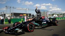 Hamilton defies boos to take Hungarian pole with 100th win in sight