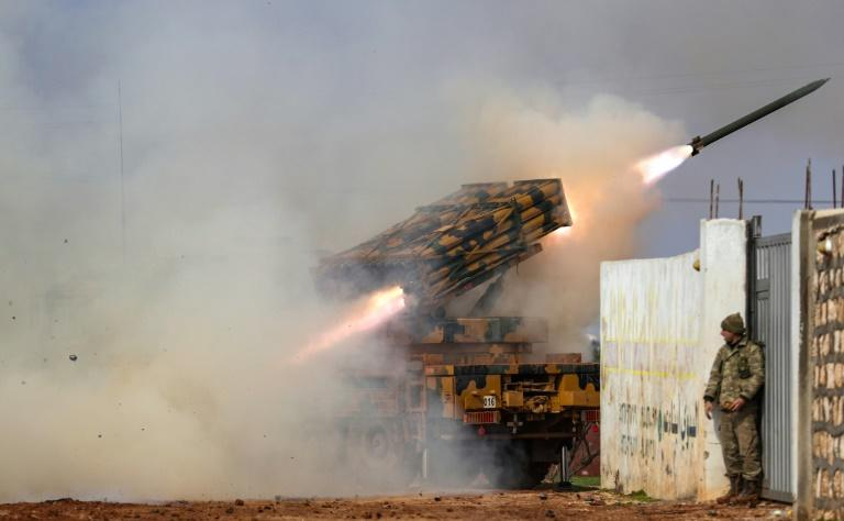 A Turkish military mobile rocket launcher fires from a position in Idlib