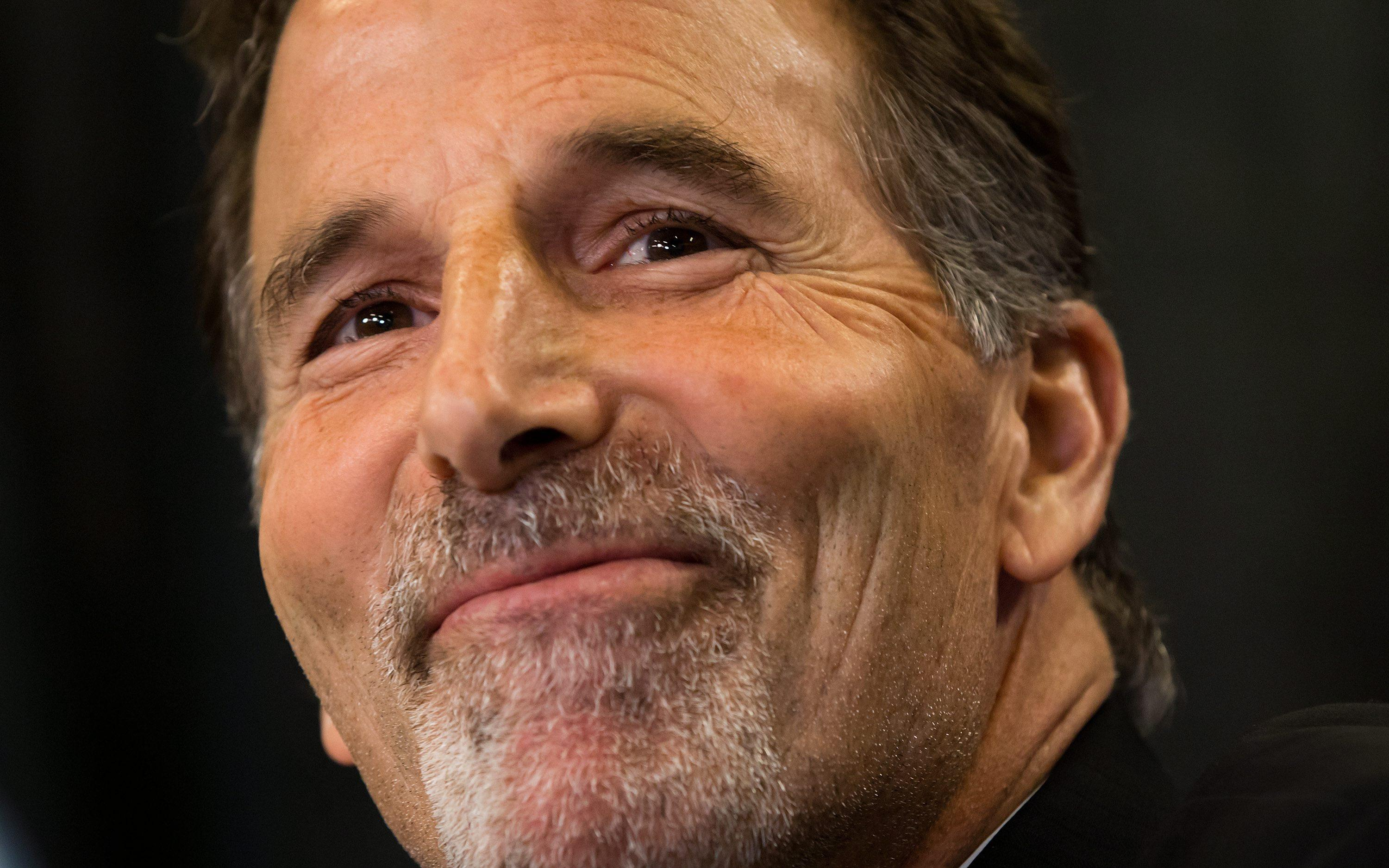 Vancouver Canucks new head coach John Tortorella smiles during an NHL hockey news conference announcing his hiring in Vancouver, British Columbia, on Tuesday June 25, 2013. (AP Photo/The Canadian Press, Darryl Dyck)