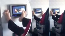 Horror as plane passenger uses his toes to browse inflight TV