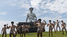Giant Borat statue air-lifted into Sydney, surrounded by mankini-clad yoga dancers