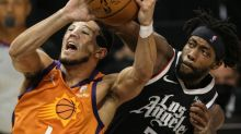 Commentary: Clippers slow down Devin Booker, who says mask is not the problem