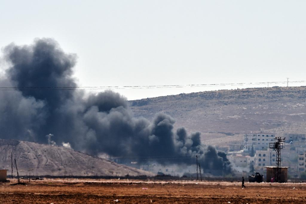 Smoke rises from the Syrian town of Ain al-Arab, known as Kobane by the Kurds, on the Turkish-Syrian border in the southeastern town of Suruc on October 6, 2014