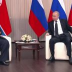 Putin and Kim shake hands at start of talks