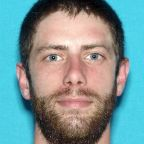 A Manhunt Is Underway for 'Armed and Dangerous' Suspect in the Killing of a Maine Officer
