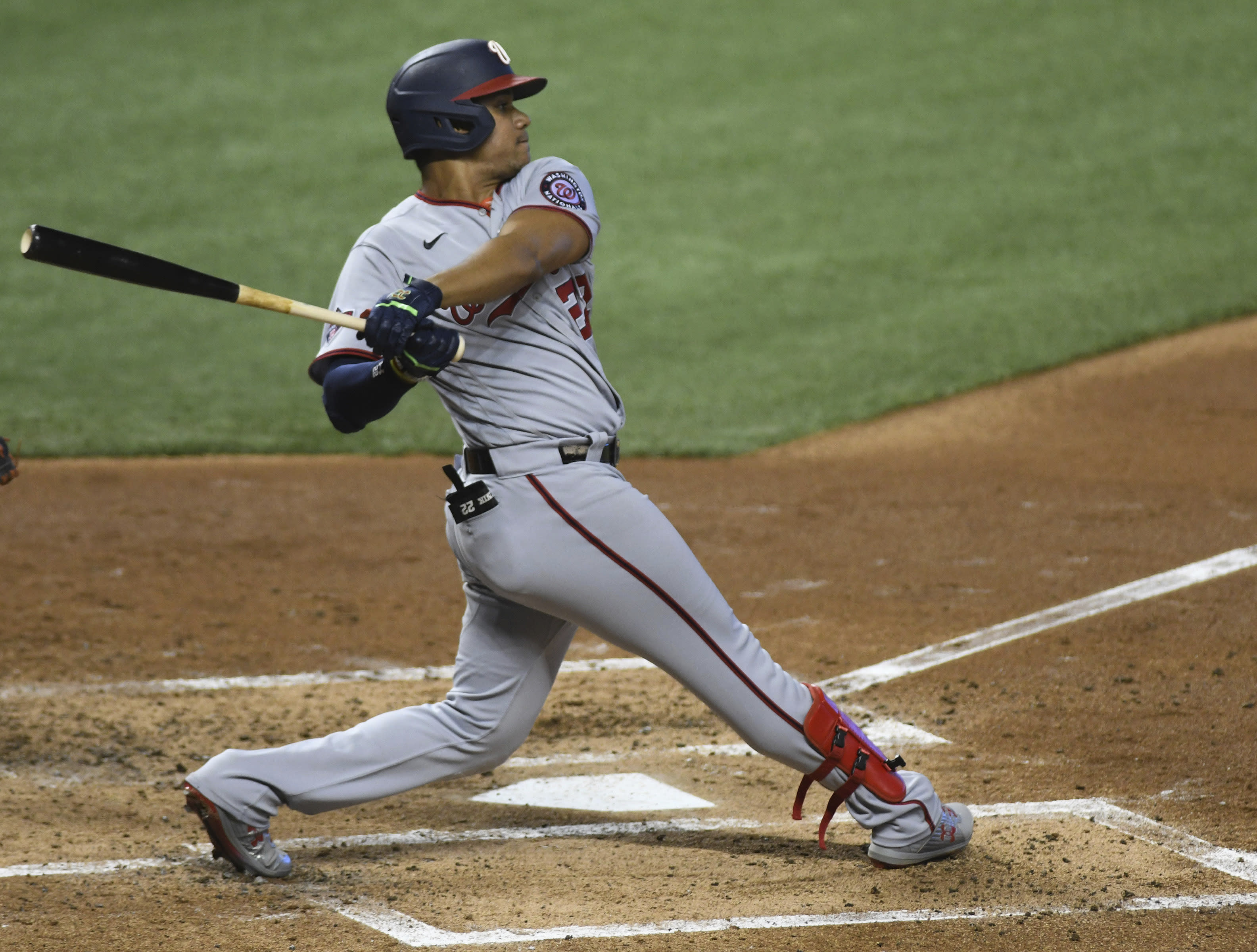 Washington Nationals Juan Soto singles during the second inning of game two of a doubleheader against the Miami Marlins, Sunday, Sept. 20, 2020, in Miami. (AP Photo/Gaston De Cardenas)