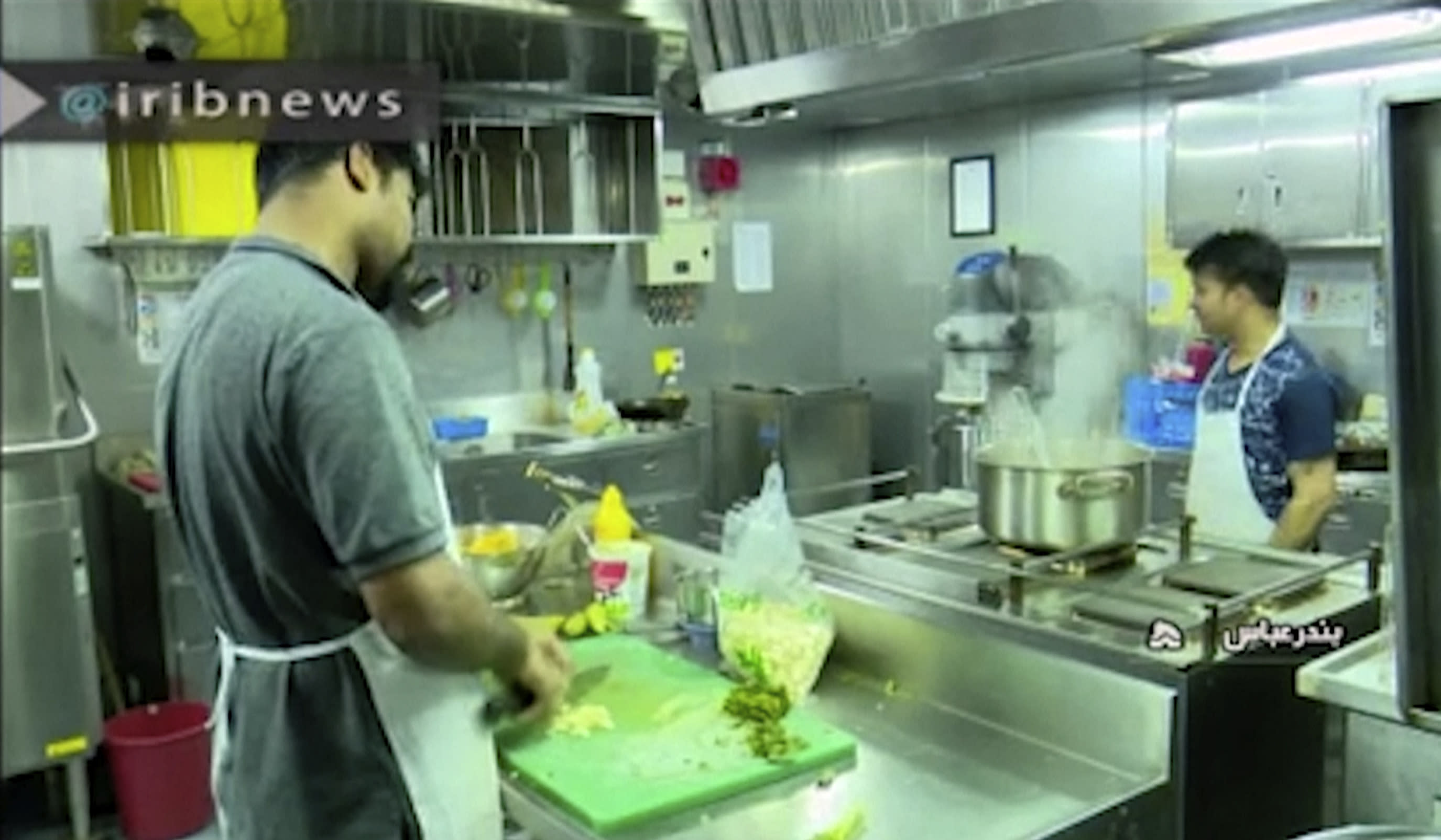 In this photo released by state-run IRIB News Agency, which aired on Monday, July 22, 2019, shows cooks in the galley of the British-flagged tanker Stena Impero that was seized by Tehran in the Strait of Hormuz on Friday. The Associated Press cannot independently verify the condition of the crew members, but in the video they looked to be in good health and it didn't appear as though they were being filmed under duress. (IRIB News Agency via AP)