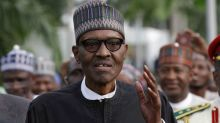 Nigeria's Buhari warns off separatists, takes back control after treatment