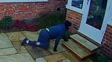 CCTV catches moment 'purr-culiar' burglar comes face to face with pet cat