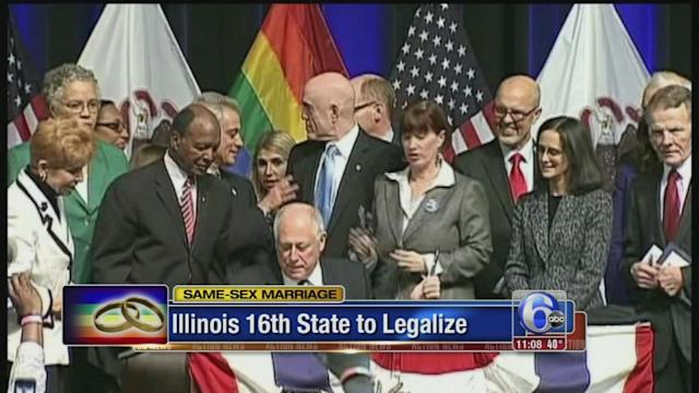 Illinois governor signs same-sex marriage into law