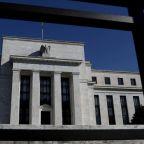 Fed officials open debate on bond taper