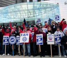 UAW will keep GM strike going while members vote on new contract