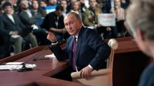 Putin takes on rivals, links Canada to scandal at press conference