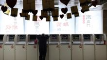 Global stocks mixed as Chinese economy slows