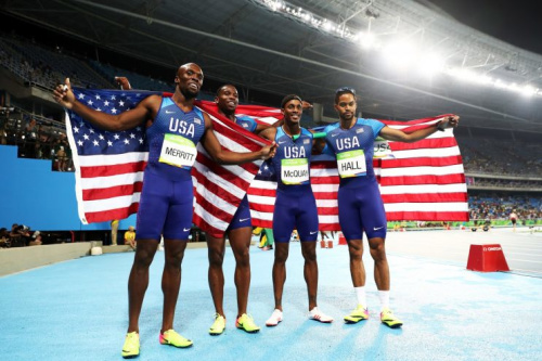 (L-R) Lashawn Merritt, Gil Roberts, Tony McQuay and Arman Hall of the United States react after winning gold in the Men's 4 x 400 meter Relay on Day 15 of the Rio 2016 Olympic Games at the Olympic Stadium on August 20, 2016 in Rio de Janeiro, Brazil. (Photo by Ezra Shaw/Getty Images)