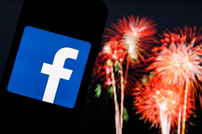 POLAND - 2020/12/30: In this photo illustration a Facebook logo seen displayed on a smartphone with fireworks in the background. (Photo Illustration by Filip Radwanski/SOPA Images/LightRocket via Getty Images)