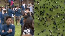 'This can't be real': 20 Sydney schools evacuated over threatening emails